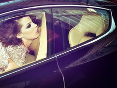 Car: Aston Martin Rapide S. Her: Evening gown by COLUNGA. Jewellery by Daniela Norinder.