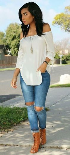 White (off the shoulder) long sleeve shirt, blue jeans, brown heals