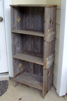 Recycled wood book shelf. Don't like the triangles, but love the wood!
