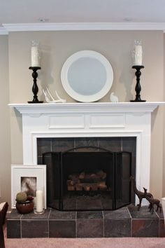 """describes how they covered a really heinous fireplace. I love the """"after"""" result. I am hoping to make the reading room fireplace this nice using their tips."""