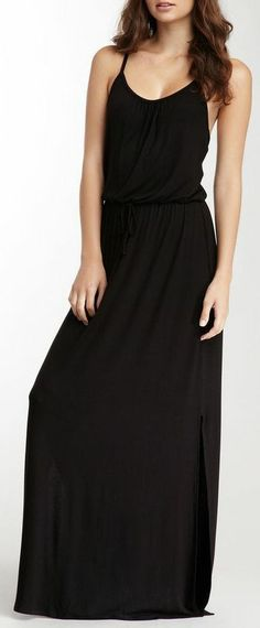 plain black drawstring dress with thin straps and a low scoop neck