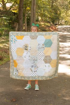 A honeycomb baby quilt using half hexagons for a bee themed gender neutral nursery.