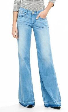 light blue mid rise raw hem wide leg flare jean from EXPRESS