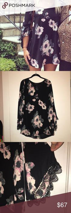 ASTR Black & Pink Floral Bell Sleeve Dress XS ASTR Black & Pink Floral Bell Sleeve Dress XS. Super cute and flowy but shows off the legs nicely. The rubber/plastic clear tag beside the ASTR tag says XS (but doesn't translate in photos). Extra small and I typically wear a size 2. Fits great.. excellent condition and barely worn.. only selling because it no longer fits my style (I work in a very corporate environment in DC). ASTR Dresses Long Sleeve