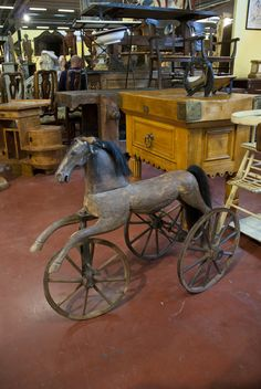 Old wooden #horse. I can just see a parent or older sibling pulling or pushing a young one around.