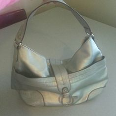Tommy Hilfiger Tommy Hilfiger Silver Shoulder Bag. Extremely cute to carry matches most everything has only been used a couple of times comes from a smoke free clean home Tommy Hilfiger Bags Shoulder Bags