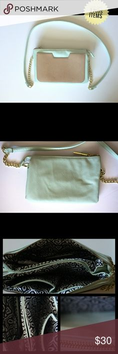Steve Madden Mint & Brown Baguette Crossbody Purse Steve Madden Mint and Brown Baguette Crossbody Purse.  Flaws- Loose string and some discoloration by the zipper and on the strap. Shown in 4th picture   The strap is also removable so this purse can be use as a clutch.   Approximate measurements all flat Length 7 in. Width 10 in. Total length of strap- 53 in.  tags mini Steve Madden Bags Crossbody Bags