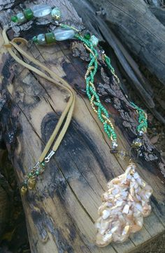 Handmade gold and sea green beaded leaf pendant necklace on Etsy, $45.00