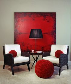 I love the red painting with the black furniture and cream cushions!