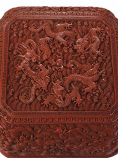 A WELL-CARVED CINNABAR LACQUER 'THREE DRAGON' BOX AND COVER, QING DYNASTY, QIANLONG PERIOD