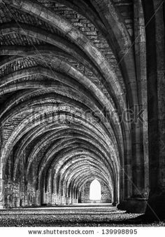 Interior of very old Gothic style monastery by veroxdale, via Shutterstock