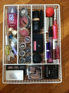 8 Ways To Organize Your Beauty Products (from The Glitter Guide) | Use a silverware trayer to organize a drawer of cosmetics.