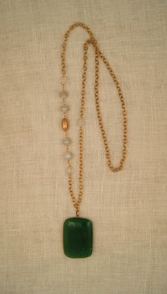 ExVoto Vintage Jewelry.  Jade pendant on long gold necklace with vintage beads of howlite, citrine and brass.