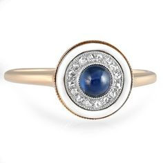 Retro-era ring features a round natural sapphire cabochon encircled by sixteen rose cut diamond accents and a halo of gorgeous white enamel.... @scrapwedo