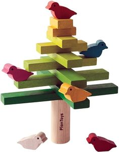 The Plan Toys Balancing Tree Game helps to develop fine motor skills. Start with the trunk and stack branches in criss-cross fashion from big to small. Once you've stacked straight to the top, try setting the six colourful birds carefully onto the branche Preschool Toys, Montessori Toys, Montessori Toddler, Toddler Toys, Baby Toys, Tree Plan, Plan Toys, Stacking Toys, Natural Toys