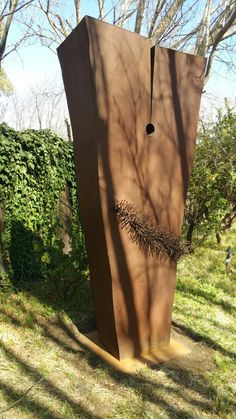 My sculpture entitled monolith placed in a beautiful garden setting.