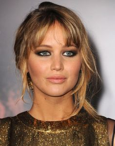 Smoky eye, nude lips and tousled hair.