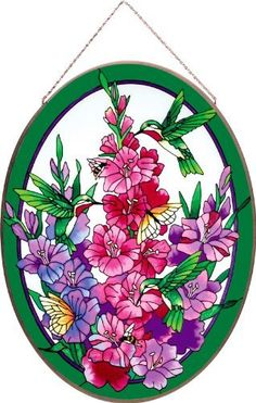 Joan Baker Designs APM806 Hummingbird/Gladioluses Glass Art Panel, 17-1/4 by 23-Inch by Joan Baker Designs. $109.99. Hand-painted art glass window panel. Turns ordinary window into an artistic statement. Vibrant emerald tones. Apm806 17.25w by 23w. Bronzed metal frame with chain. Glorious glads share their nectar with hummingbird friends in this Art Panel. Vibrant colors and rich detail make this hand-painted art glass piece a treasured gift or element of home décor for ...