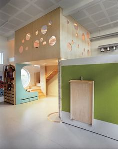 Several of the Tromsø kindergartens feature hinged walls, like the one shown here. These movable partitions create the opportunity to divide spaces into large or small areas. The walls also feature built-in furniture, drawers, whiteboards, climbing walls, and more.
