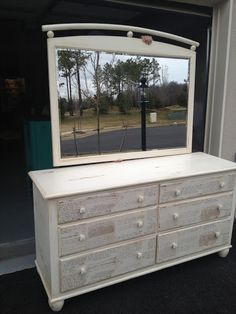 Painted with ASCP in Old White with clear and dark wax. Drawers decoupaged with Ballard's document wrapping paper.