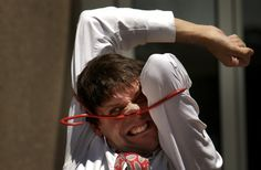 DENVER, CO, JUNE 27, 2003- .Rob  Torres  of New York City squeezes his body…