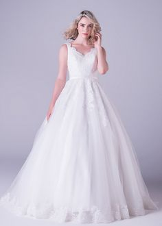 Bride&co wedding dress, Tulle ballgown dress finished with with a delicate lace border. The back of the gown is rounded off with a beautiful bow detail.
