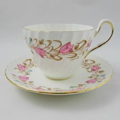 Foley tea cup and saucer in the Harebell pattern. Beautiful hand painted pink flowers on the cup and saucer. Gold trimming on cup and saucer edges. In excellent condition (see photos). Markings read: Foley Bone China Made in England Harebell Please bear in mind that these are vintage