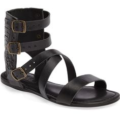 Antiqued metal studs and woven details distinguish this gladiator-inspired sandal.