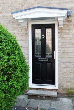 A Recent, Contemporary Installation Beautiful Altmore Composite Door in Black , with Contemporary Zinc Prairie Glass Design and Chrome Letterbox, Handle and urn Knocker, all Completed with Rehau High quality UPVC Framework, with a beautiful Overhead UPVC Canopy in Grey. Adding a Canopy to your home can be a fantastic tool, Not only for the Practicality of keeping you sheltered in the rain whilst you find your keys, but also look fantastic and add a beautiful Feature to the Front of your Home