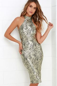 Bring the shine to any party or gathering you attend with the dazzling Palmetto Gold Print Bodycon Midi Dress! Textured knit fabric has a botanical print in an eye-catching metallic gold and black. Mock neck fastens at back with two buttons above a keyhole, while wide arm openings introduce a bodycon dress with a chic, midi-length hem.