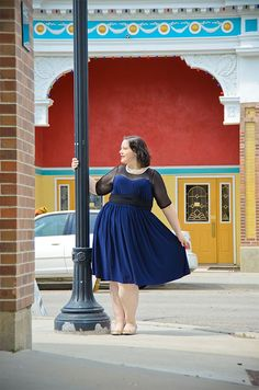 Gwynnie Bee member Toni wears the @Kiyonna Plus Size Clothing  Twirl & Swirl Cocktail Dress in Navy in her Not a Model photo shoot