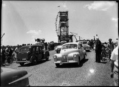 """[Holden crosses at the] opening of the Hexham Bridge, Newcastle, 17 December 1952 / Sam Hood    Holden 48/215 or FX model, """"Australia's own car"""".    Find more detailed information about this photograph: acms.sl.nsw.gov.au/item/itemDetailPaged.aspx?itemID=31320    From the collection of the State Library of New South Wales www.sl.nsw.gov.au"""