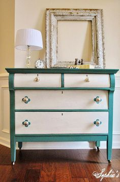 Milk Paint Dresser Rehab: love the background color with white drawers. Add more detail around the knobs?