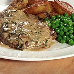 Sirloin steak smothered in a creamy sauce.