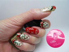 Kisses Under The Mistletoe Nails is a lovely bright, sparkly design for Christmas. Combines a gold glitter base with bright red, deep green and creamy white