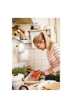 Woman Washing Carrots for Healthier Eating