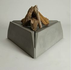 12 Urban Style Indoor-Outdoor Concrete Pieces. Intelligently designed,this piece by Hard Goods puts the fire ten inches of f the ground, above vertical slats that allow drainage and let in air to feed the flames