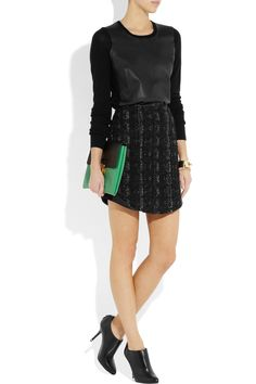 Different textures prevent all black outfit from being boring – DKNY top, Antonio Berardi skirt, Givenchy shoes, Marni clutch