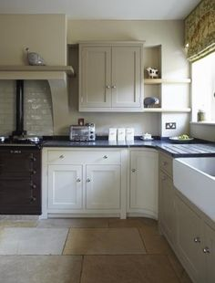 Save money by keeping your kitchen units, but replacing doors, surfaces and worktops. Image by Farrow and Ball,