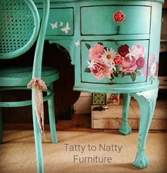 Turquoise vintage painted dressing table with decoupage pink roses, daisies and butterflies cut from white paper.