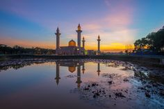 A Reflection of a Mosque at Sunrise by Hafiz Ismail on 500px... #architect #architecture #asia #attraction #azan #building #culture #design #dome #dusk #eid #faith #god #house of worship #islam #islamic architecture #landmark #lighttrail #malay #malaysia #masjid #minaret #morning #mosque #muslim #night #oriental #palace