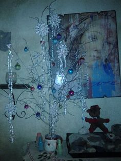 Christmas branch with twirling ribbons, and ornaments and snowflakes dipped in glitter epsom salt and tada! Pretty fun.