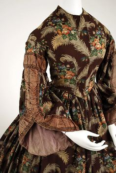 Dress  Date: ca. 1850 Culture: American Medium: silk, wool Dimensions: (bodice) Length at CB: 16 in. (40.6 cm) (skirt) Length at CB: 42 1/2 in. (108 cm)
