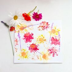 """You need flowers from your garden and a piece of white cloth for each child. Using a hammer or a flat rock, have the children pound the flower into the cloth/paper. The flowers """"stain"""" the material, leaving an impressionist style painting."""