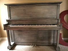 This piano has been painted and glazed to look antique <3  Love that!