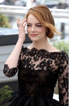 Emma Stone arrives wearing a black lace Oscar de la Renta mini with organza ruffles. Cannes 2016