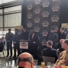 Army and Navy captains being receiving citations from the mayor of Philadelphia, Michael Nutter.