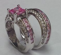 The Spoiled Princess in Pink! These flawless pink topaz fill the center line of both bands and mark the top of the engagement band with the largest one. The sides of each band hold smaller white topaz that wrap around the pink. In a 10k white gold filled setting. www.cloverkitty.com #alternativeweddingrings #shopcloverkitty #wedding #ring #engagement