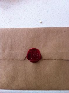 The envelopes for DIY Save the Dates! These were fun to do! :  wedding black diy invitations old fashioned red vintage wax seal white Wax Seal