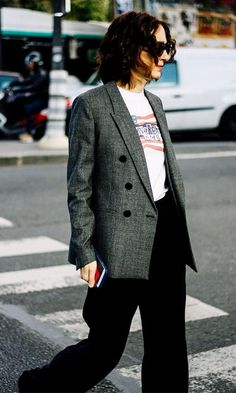 Layer a graphic tee underneath your blazer, and style with wide-leg pants.... - Street Style